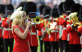 th_24988_celeb-city.org-The_Elder-Katherine_Jenkins_2009-07-08_-_sings_the_Welsh_national_anthem_before_the_game_433_122_473lo.jpg